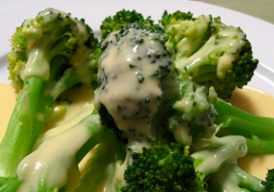 Easy cheese sauce poured over broccoli